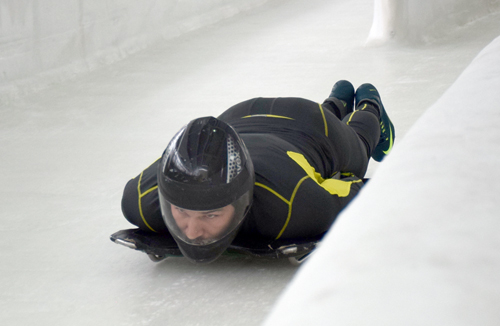 Wounded veteran Robbie Gaupp enters the Mount Van Hoevenberg track on a skeleton sled from start three Friday morning as part of the Adaptive Sports Foundation's bobsled and skeleton program. (Enterprise photo — Justin A. Levine)