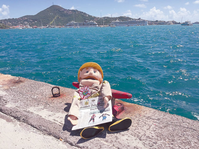 The winner of last year's Vacation Photo Contest was Saranac Lake Fire Chief Brendan Keough's well-traveled puppet, dubbed LDH, which was stolen by fellow firefighters and posed in locations far and wide, sending photos as souvenirs. Here LDH enjoys the Adirondack Daily Enterprise in St. Thomas, in the U.S. Virgin Islands.