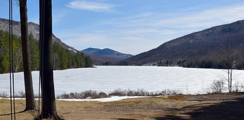 Loon Lake Mountain, one of several attractions in the Debar Mountain Wild Forest complex, is seen from the front steps of the Debar Pond Lodge in Duane earlier this week as the slopes of Debar Mountain, right, and Baldface Mountain, left, rise above the pond. (Enterprise photo — Justin A. Levine)