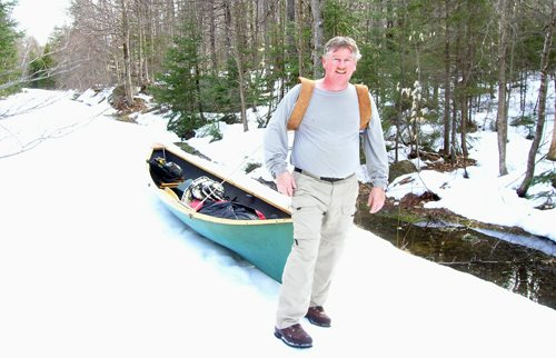 Joe Hackett is ready for anything as he skids a boat across the snow on the way to go fishing. (Photo provided)