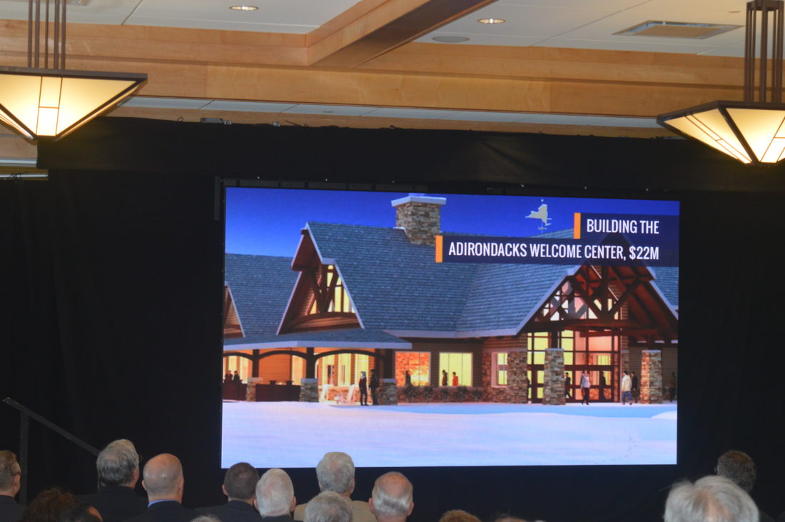 "Here is some artwork of the Frontier Town ""Gateway to the Adirondacks"" project Gov. Andrew Cuomo presented as part of his state budget talk Friday at the Lake Placid Conference Center. (Enterprise photo — Antonio Olivero)"