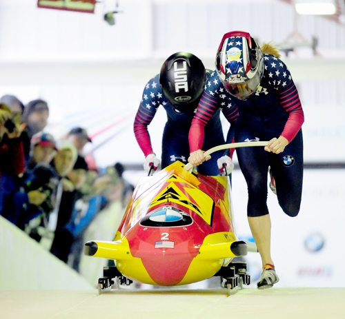 American driver Jamie Greubel Poser and teammate Aja Evans push their sled during the women's World Cup bobsled race at Mount Van Hoevenberg in December. The pair, who hadn't raced together since the 2014 Sochi Olympics, set a new track record on this run and claimed the gold medal. (Enterprise file photo — Lou Reuter)
