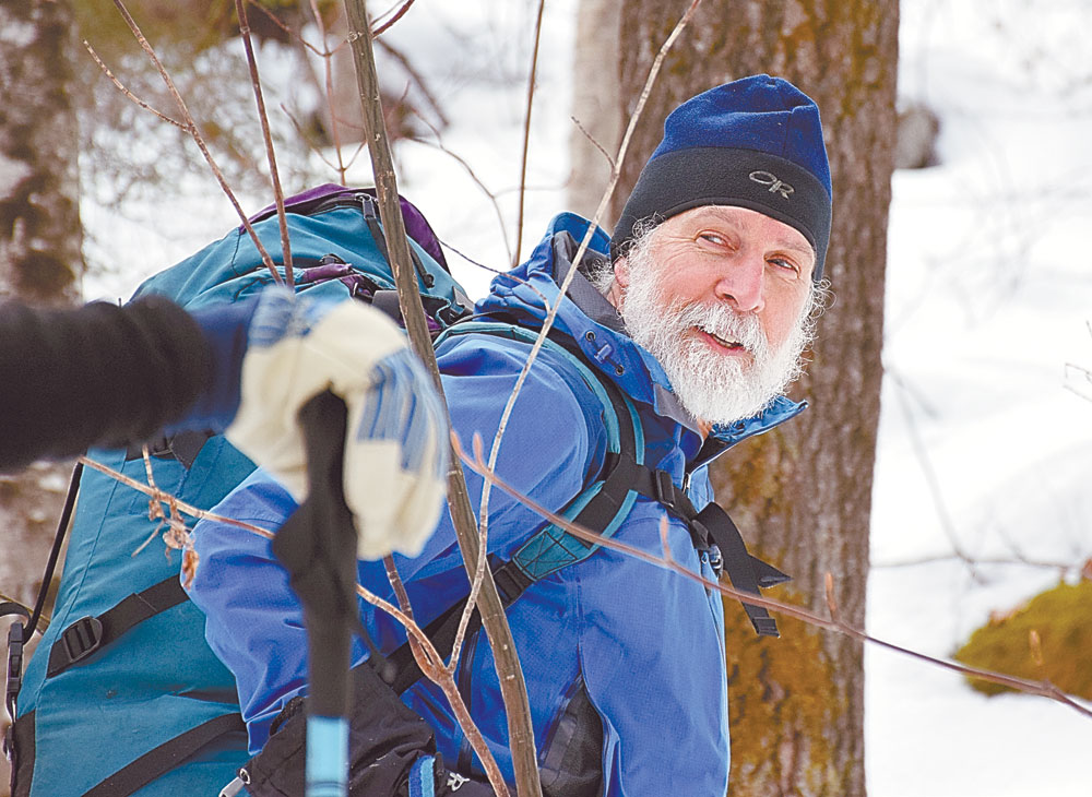 Carl Heilman II smiles as he leads a snowshoe bushwhack in Keene Valley as part of this year's annual Mountainfest in January. (Enterprise photo — Justin A. Levine)