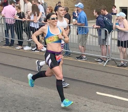 Amy Farrell, of Tupper Lake, appears to be having a blast as she competes in Monday's Boston Marathon. Farrell finished in 2:59:23 and was the 89th female overall. (Photo provided)