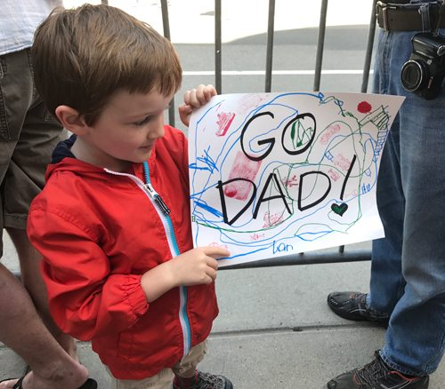 Finn Wellford holds up a sign he made for his dad Monday in Boston. (Photo provided)