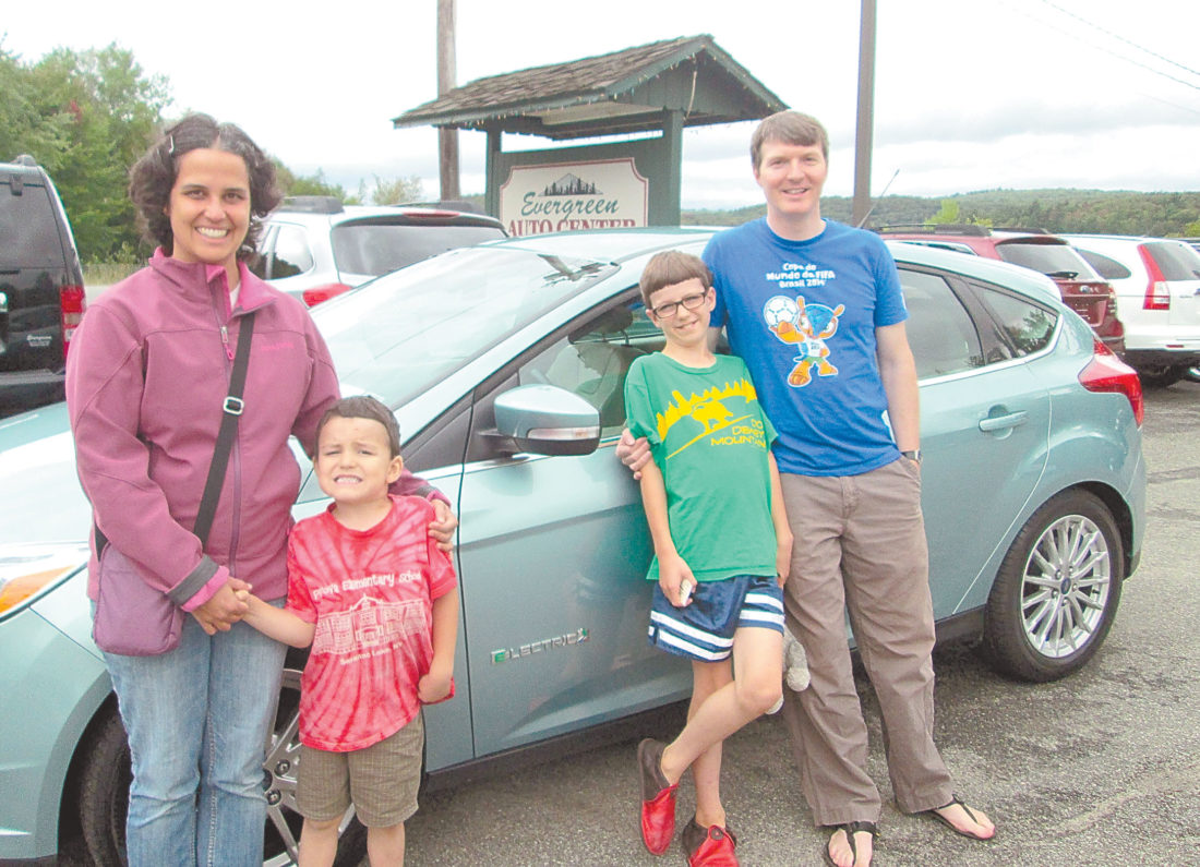 From left, Sunita, Oliver, Galen and Steve Halasz smile as they pick up their newly purchased, fully electric Ford Focus from Evergreen Auto Center in Saranac Lake in August 2014. (Photo provided by Sunita Halasz)