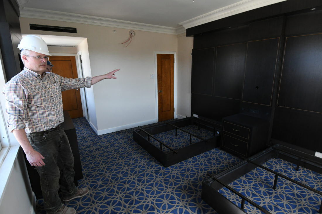 Tad Schrantz shows off one of the Hotel Saranac's nearly completed rooms on the sixth floor. (Enterprise photo — Lou Reuter)