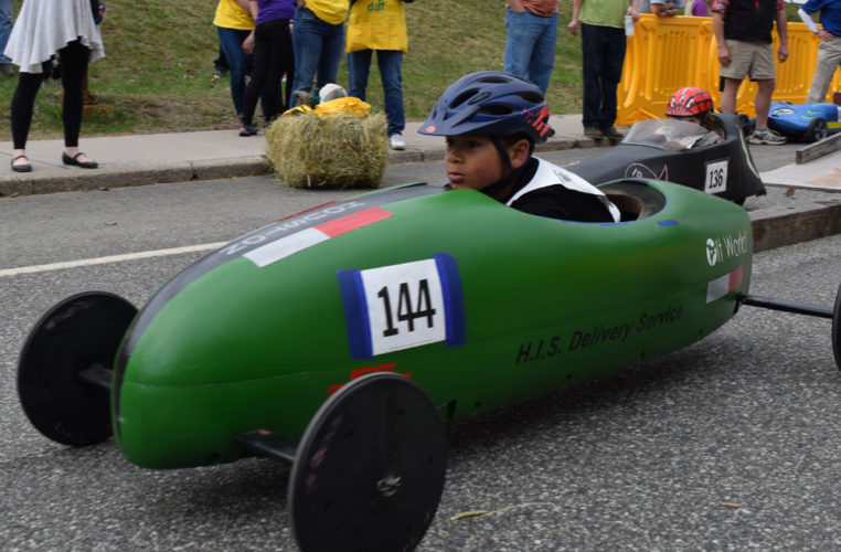 Houston Shortell takes off down LaPan Highway hill in Saranac Lake during Saturday's seventh-annual Daffest Derby soap-box car races. (Enterprise photo — Chris Knight)