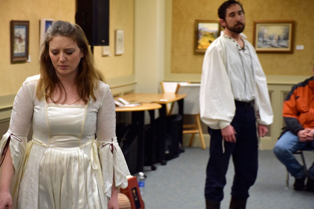 Tara Bradway and Patrick Siler act out a romantic scene while giving a synopsis of true love in William Shakespeare's plays during First Night Saranac Lake on Dec. 31, 2014 at the Saranac Lake Free Library. (Enterprise photo — Peter Crowley)