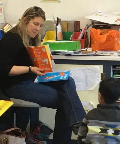 Rotarian Jordanna Mallach reads to elementary students. (Photo provided)