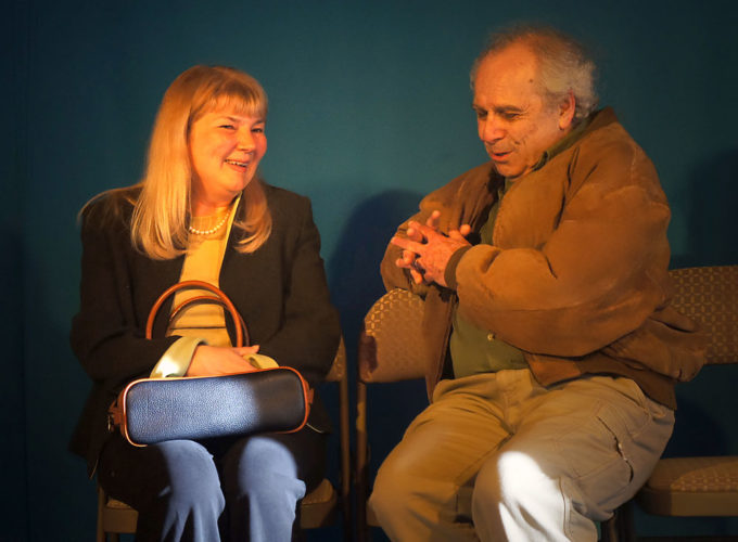 """Kathy Recchia and Jordan Hornstein rehearse a flirtatious scene from """"The Last Romance,"""" a play that opens tonight at BluSeed Studios in Saranac Lake. (Photo provided by Adirondack Stage Rats)"""