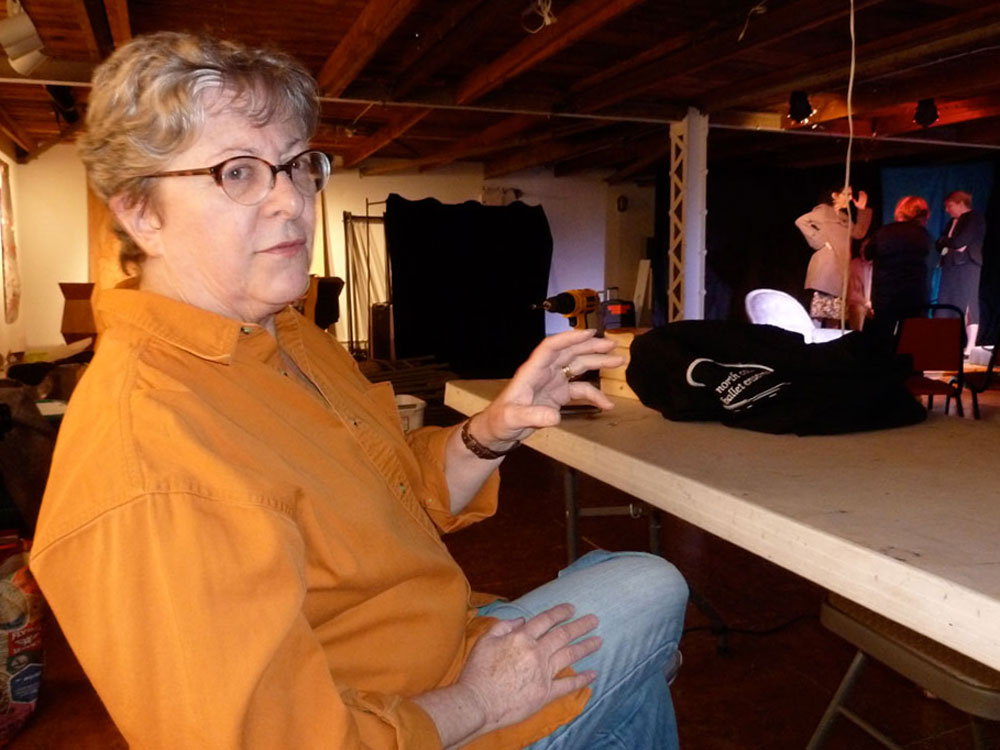 """Karen Lewis, co-founder of the Adirondack Stage Rats, talks Tuesday night during a dress rehearsal of """"The Last Romance,"""" a play that opens tonight at BluSeed Studios in Saranac Lake. (Enterprise photo — Peter Crowley)"""