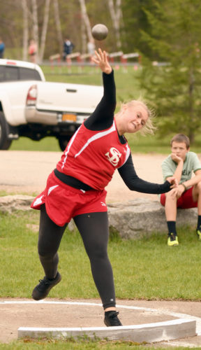 Olivia Atkinson unleashes a shot put throw in Thursday's meet. The Red Storm senior swept the throwing events with wins in the shot and discus. (Enterprise photo — Lou Reuter)