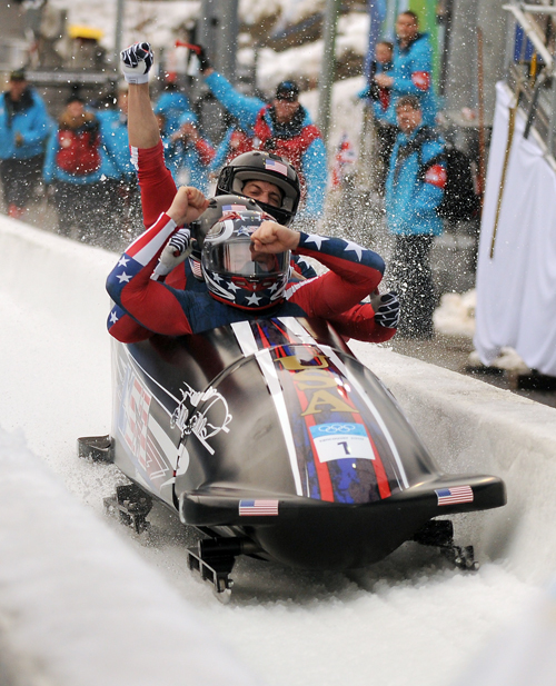 Steve Holcomb and his crew of Justin Olsen, Steve Mesler and Curtis Tomasevicz triumphantly ride the Night Train four-man bobsled up the finish ramp as they complete the fourth and final run during their gold-medal performance at the 2010 Winter Olympics in Vancouver, Canada. (Enterprise file photo — Lou Reuter)