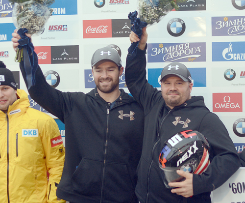 Steve Holcomb, right, celebrates a two-man bobsled World Cup victory along with his brakeman Carlo Valdes at the Mount Van Hoevenberg track in Lake Placid on Jan. 8, 2016. Holcomb was one of the most successful bobsled pilots in United States history, a career which included a four-man victory at the 2010 Winter Olympics in Vancouver. (Enterprise file photo — Lou Reuter)