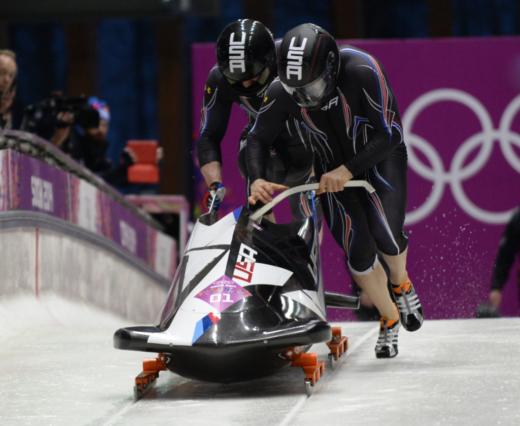 Steve Holcomb and Steve Langton launch their bobsled in the Winter Olympics on Feb. 17, 2014, in Krasnaya Polyana, Russia. They won a bronze medal, breaking the U.S.'s 62-year medal drought in two-man bobsledding. (Enterprise photo — Lou Reuter)