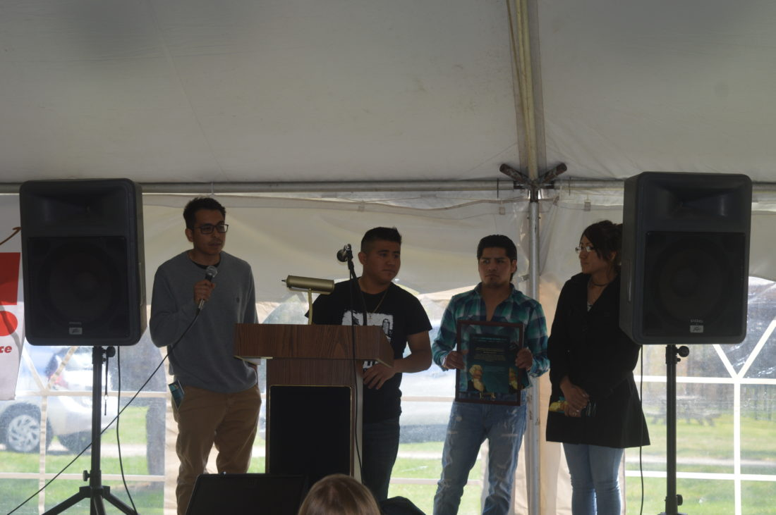 Members of the Vermont-based farm worker rights activist group Justicia Migrante — originally from Chiapas, Mexico — receive their Spirit of John Brown Freedom award Saturday. (Enterprise photo — Antonio Olivero)