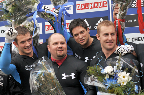 Steve Holcomb, second from left, celebrates with the rest of his his four-man crew of Justin Olsen, Steve Mesler and Curtis Tomasevicz at the World Cup event in Lake Placid in November 2009. (Enterprise photo — Lou Reuter)