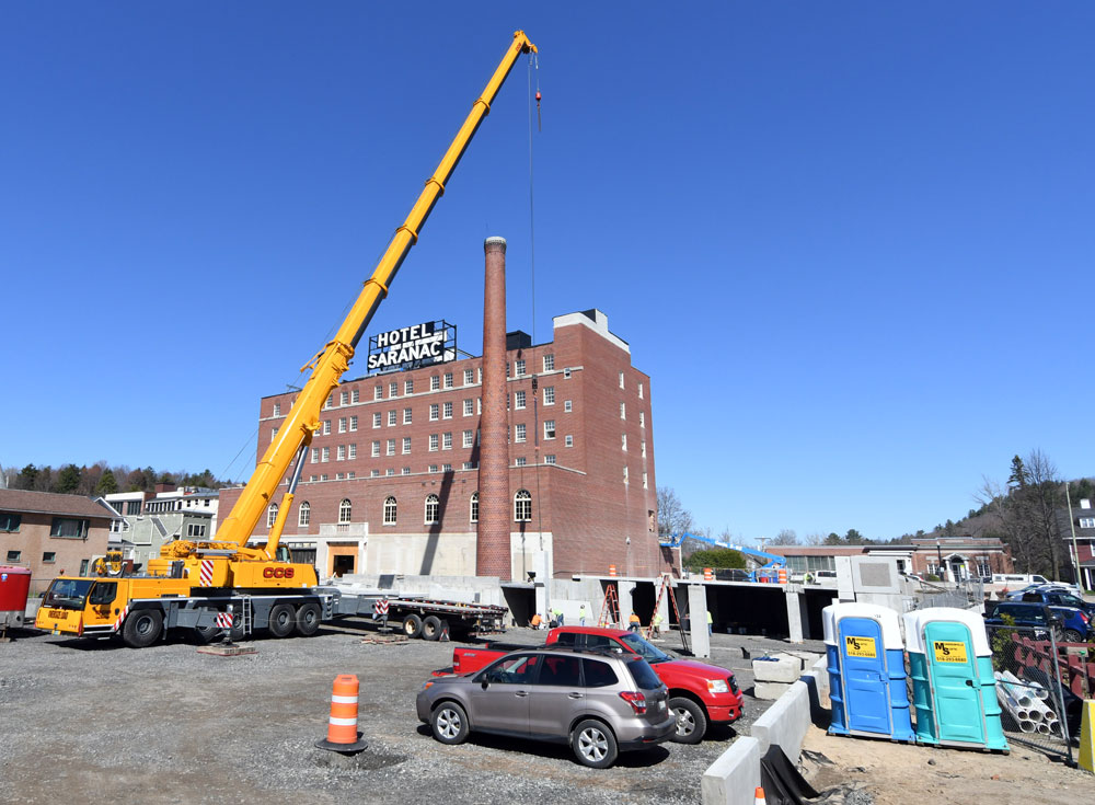 The Hotel Saranac, owned by Roedel Companies, is being renovated in the center of downtown Saranac Lake, as seen in late April. (Enterprise photo — Lou Reuter)