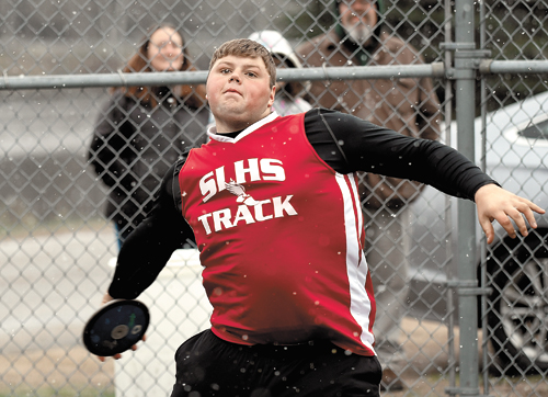 "Saranac Lake sophomore Jonathan Hewitt winds up in the  discus event  during  Monday's track and field meet against Saranac  Central. Hewitt  won the  competition with a throw of 126'6.5"" inches, which is the top toss in the  Champlain Valley Athletic Conference this season. (Enterprise photo — Lou Reuter)"