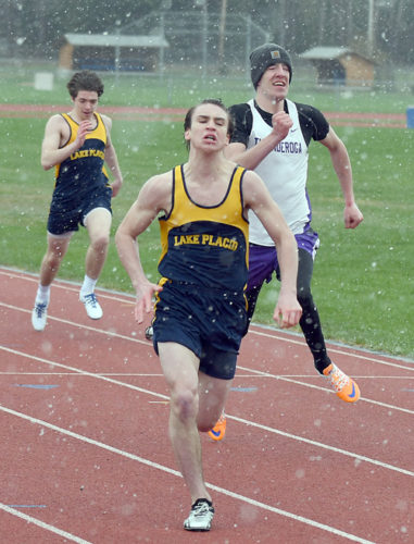 Carter Grady of Lake Placid heads toward the finish line during his winning effort in the 100-meter dash in Tuesday's high school track meet against Ticonderoga. (Enterprise photo — Lou Reuter)