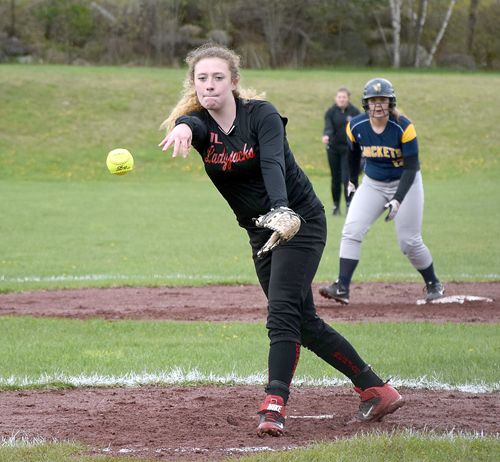 Tupper Lake's Rebecca Delair tosses a pitch Tuesday afternoon during the first of two games against Madrid-Waddington at L. P. Quinn Elementary School. (Enterprise photo —Justin A. Levine)