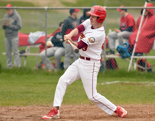 Saranac Lake senior Brandon Meyer rips into a pitch for a triple during the fifth inning of Wednesday's game against Moriah in Saranac Lake. (Enterprise photo — Lou Reuter)
