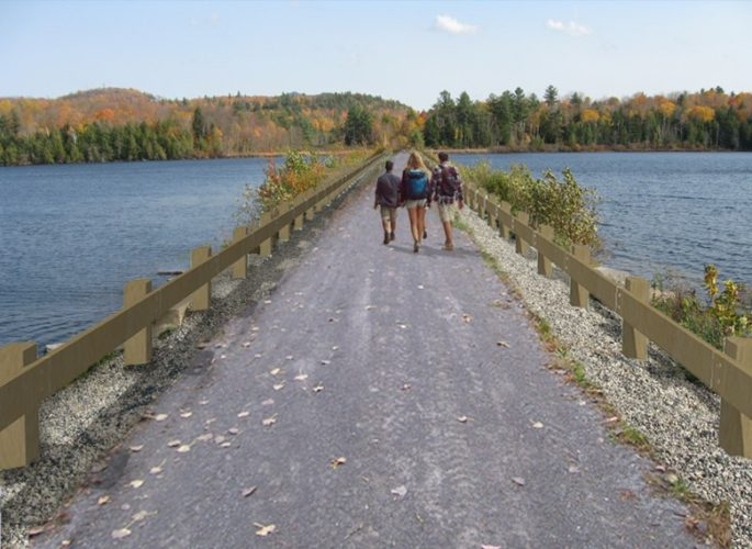 This artist's rendering shows what a trail is expected to look like, replacing railroad tracks along the Lake Colby causeway just outside Saranac Lake village.