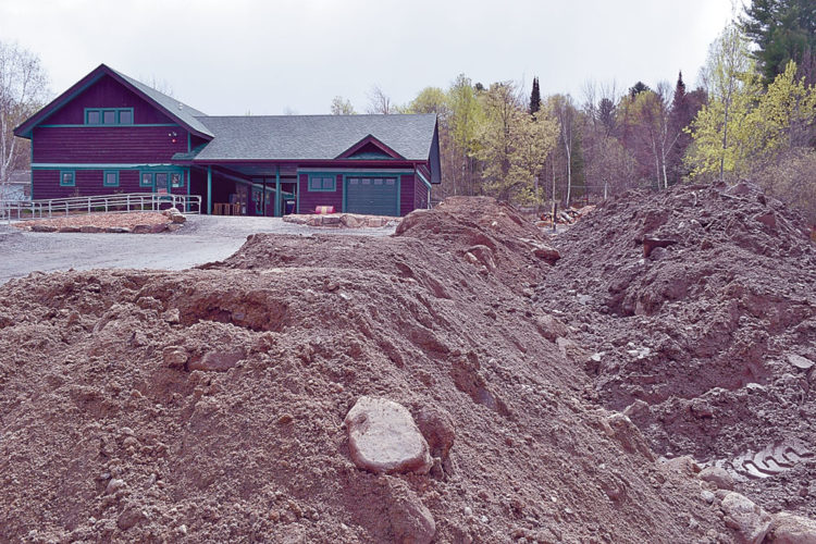 Piles of fill, seen Tuesday, cover where the parking lot of Dewey Mountaion Recreation Area will be expanded. (Enterprise photo — Chris Knight)
