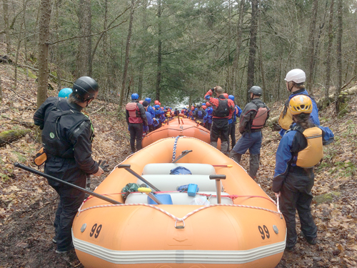 Students from Northwood School and the Wanakena Ranger School line up to launch their rafts into the Indian River. (Enterprise photo — Justin A. Levine)