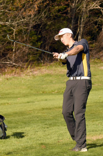 Bjorn Kroes watches his approach shot head toward the 15th green during Thursday's high school match. The Blue Bombers senior was one of three golfers who shared medalist honors with rounds of even-par 35s. (Enterprise photo — Lou Reuter)