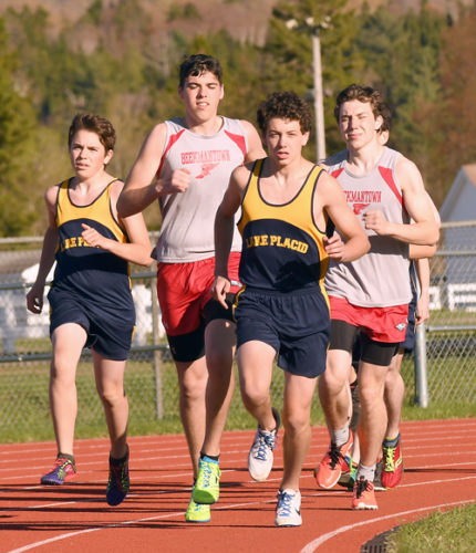 Lake Placid freshman James Flanigan stays ahead of the pack during the 3,200-meter race Thursday against Beekmantown. Flanigan led from start to finish to win with a personal-best time of 10:52. (Enterprise photo — Lou Reuter)