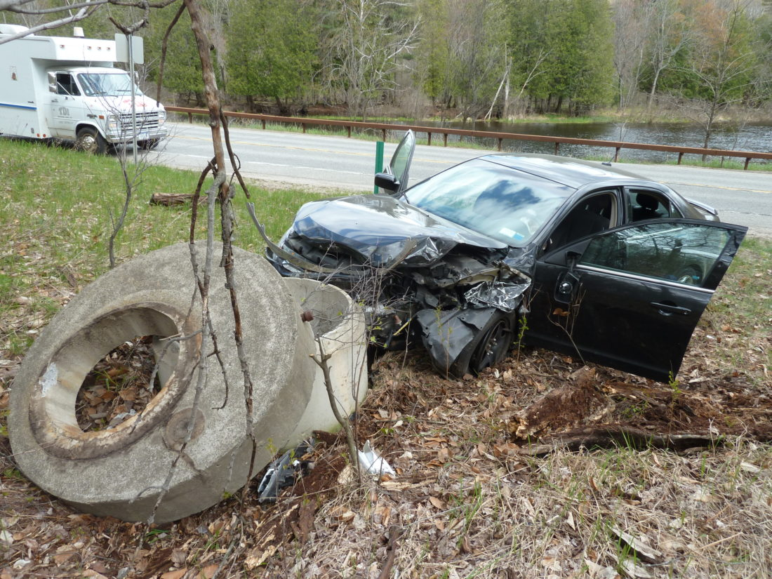 This car collided head-on with a pickup truck and then crashed into this concrete structure Friday afternoon on Bloomingdale Avenue in Saranac Lake. (Enterprise photo — Peter Crowley)