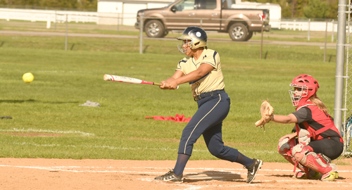 Makeda Thompson raps out a single for Lake Placid early in Tuesday's high school softball game against Beekmantown. (Enterprise photo — Lou Reuter)