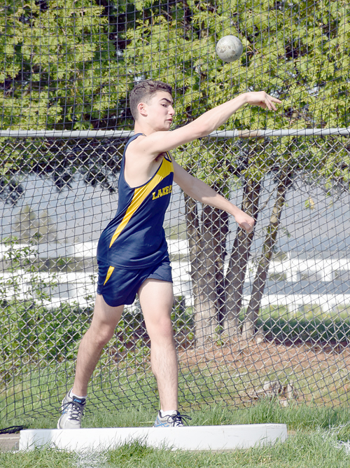 Lake Placid's Justin Novick throws the shot put during Wednesday's meet against EKMW at the North Elba Show Grounds. (Enterprise photo — Justin A. Levine)
