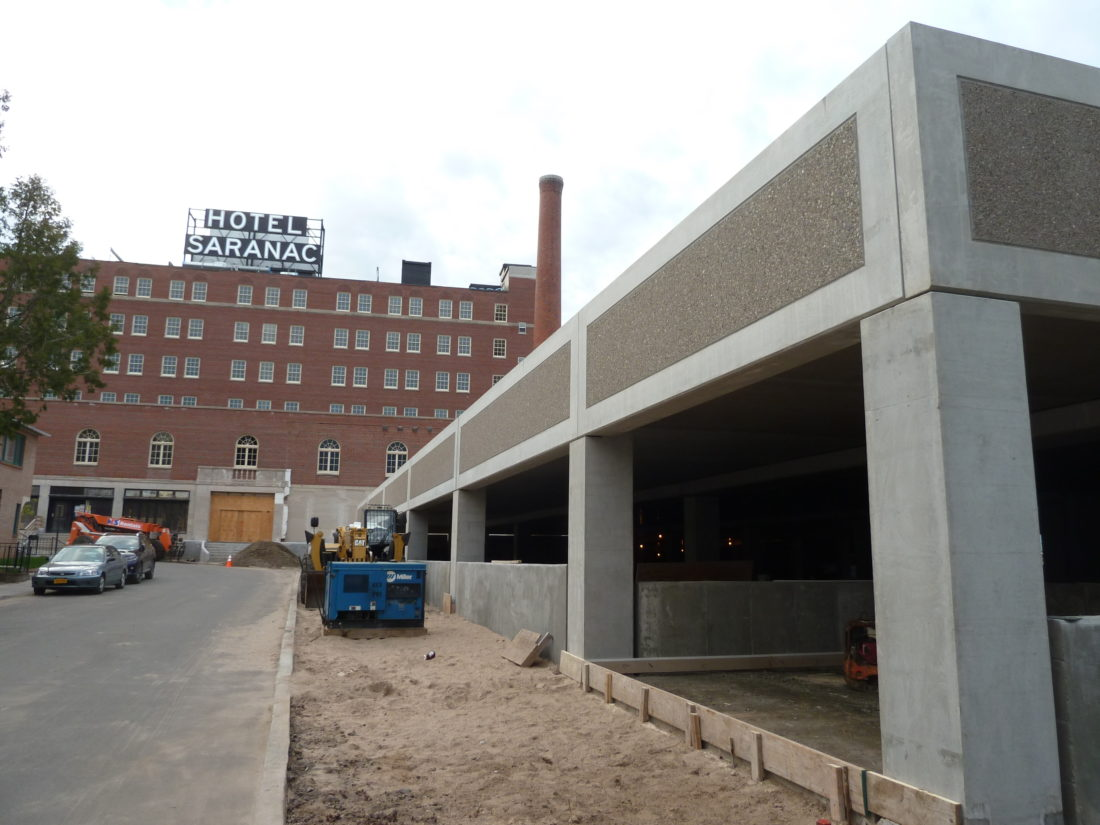 The Hotel Saranac's two-level parking garage is being finished, as seen Tuesday on Academy Street in Saranac Lake. (Enterprise photo — Peter Crowley)