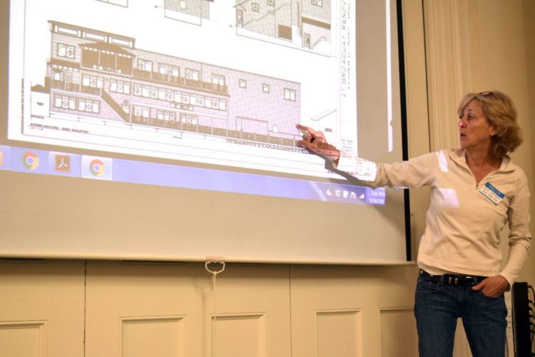 Calli Shelton outlines the latest plans for renovation of the former Dew Drop Inn at 27 Broadway in Saranac Lake during a village Development Board meeting Tuesday. (Enterprise photo — Chris Knight)