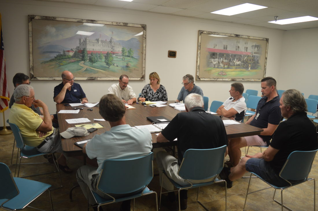 Members of the village Lake Placid Board of Trustees and the North Elba Town Council discuss amendments to the village and town's joint land-use code at Thursday's special meeting at the North Elba Town Hall. (Enterprise photo — Antonio Olivero)
