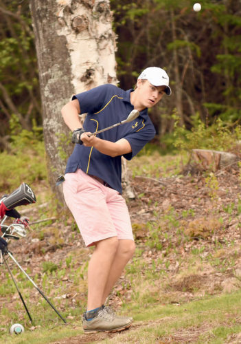 Lake Placid senior Ryan Kane chips onto the 13th green during Thursday's match against rival Saranac Lake at Craig Wood. (Enterprise photo — Lou Reuter)