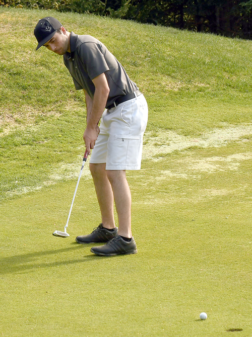 Senior Tanner Courcelle, the Red Storm's top golfer, rolls a putt on the 14th green in Thursday's match against Lake Placid. (Enterprise photo — Lou Reuter)