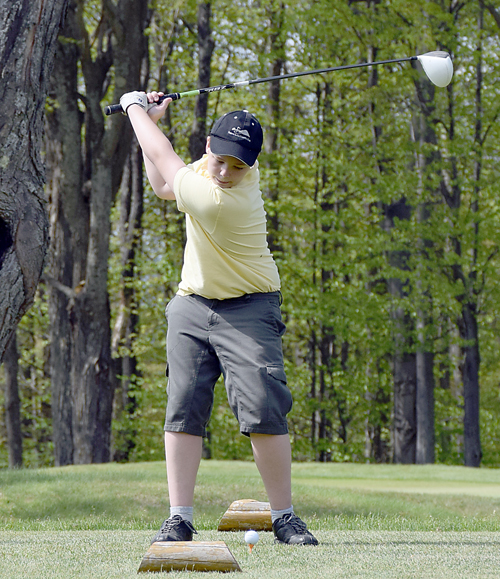 Tupper Lake eighth-grader Pat Clark tees off during Thursday's match against Norwood-Norfolk. (Enterprise photo — Justin A. Levine)