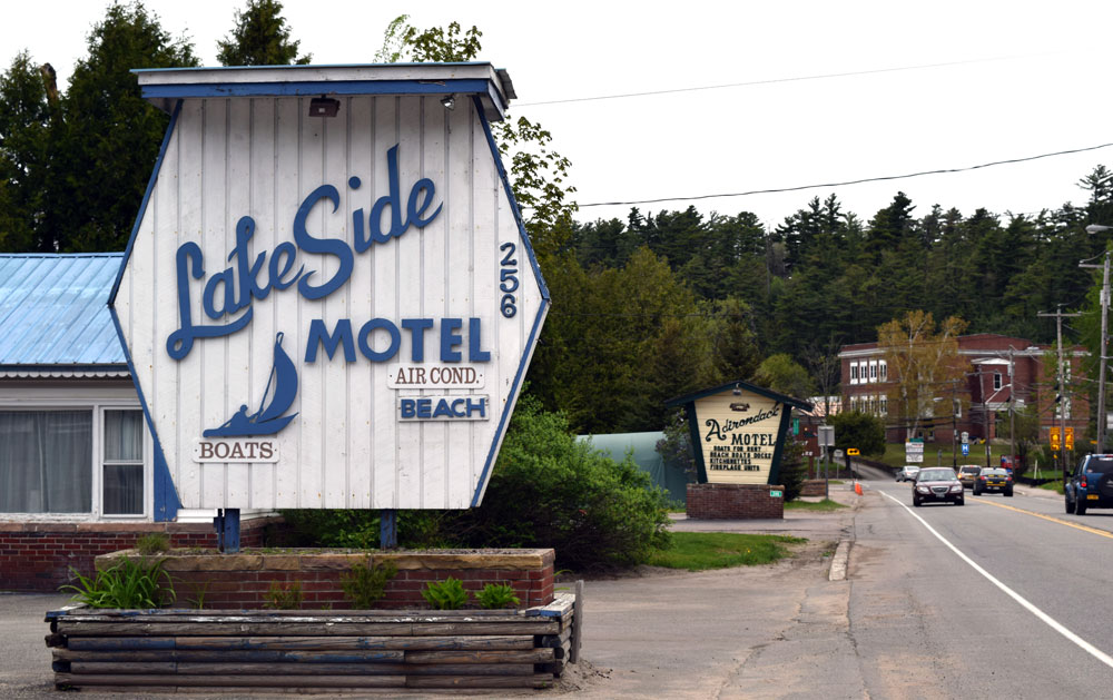 The signs for the Lake Side Motel and Adirondack Motel are seen Friday on Lake Flower Avenue on Saranac Lake. A third motel in this row, the Lake Flower Inn, is just past the Adirondack Motel. (Enterprise photo — Chris Knight)