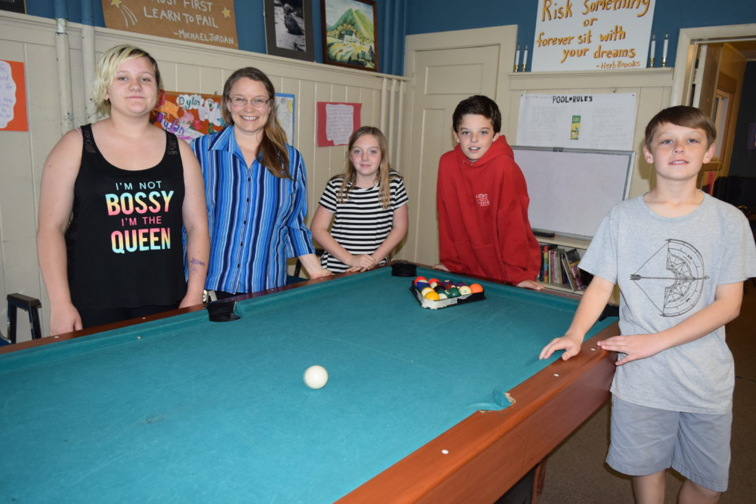 Kids at the Saranac Lake Youth Center pose for a picture Monday with the center's new director Aleacia Landon, second from left. Also pictured, from left, are Chantell Myatt, Kyla Callaghan, Zyler Strack and Ryan Gallagher. (Enterprise photo — Chris Knight)