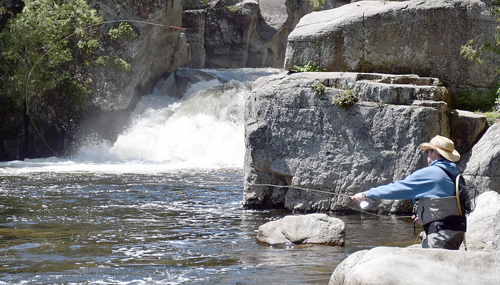 A fisherman casts for trout below the Flume in Wilmington during the second day of the Ausable River Two-Fly Challenge fishing tournament on Saturday. (Enterprise photo — Justin A. Levine)