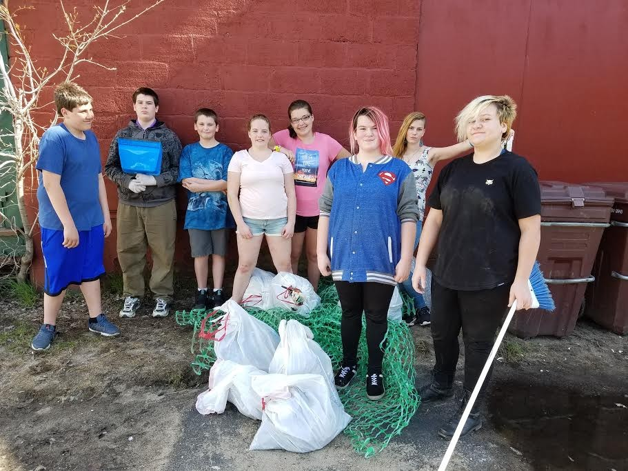 On April 28, Saranac Lake Youth Center youngsters participated in the United Way Day of Caring by picking up trash near the youth center on Woodruff Street, Church Street and at the Skatepark. (Photo provided)