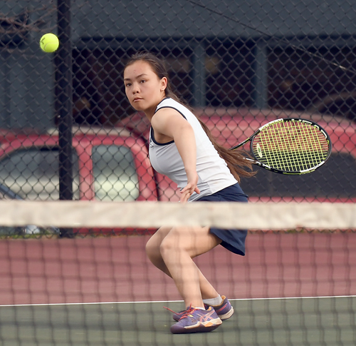 Lake Placid seventh-grader Sonja Toishi competes in second singles in the Blue Bombers' season-opening  match in April against Plattsburgh. After going unbeaten in CVAC play, she went on to win the Section VII girls singles crown. (Enterprise photo — Lou Reuter)