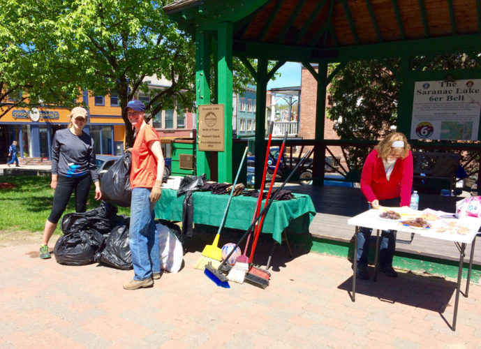 From left, Hannah Gibbons-Author of Saranac Lake, Emily Martz of the Saranac Lake Downtown Advisory Board and Barb Martin of the Saranac Lake Women's Civic Chamber take part in a village cleanup Saturday, May 20 in Berkeley Green. (Photo provided — Tim Fortune)