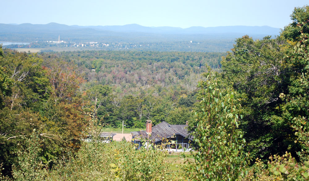 Forested land the Adirondack Club and Resort developers bought from the Oval Wood Dish Corporation Liquidating Trust is seen from Big Tupper Ski Area on Mount Morris, with the village of Tupper Lake in the background. (Enterprise photo — Mike Lynch)