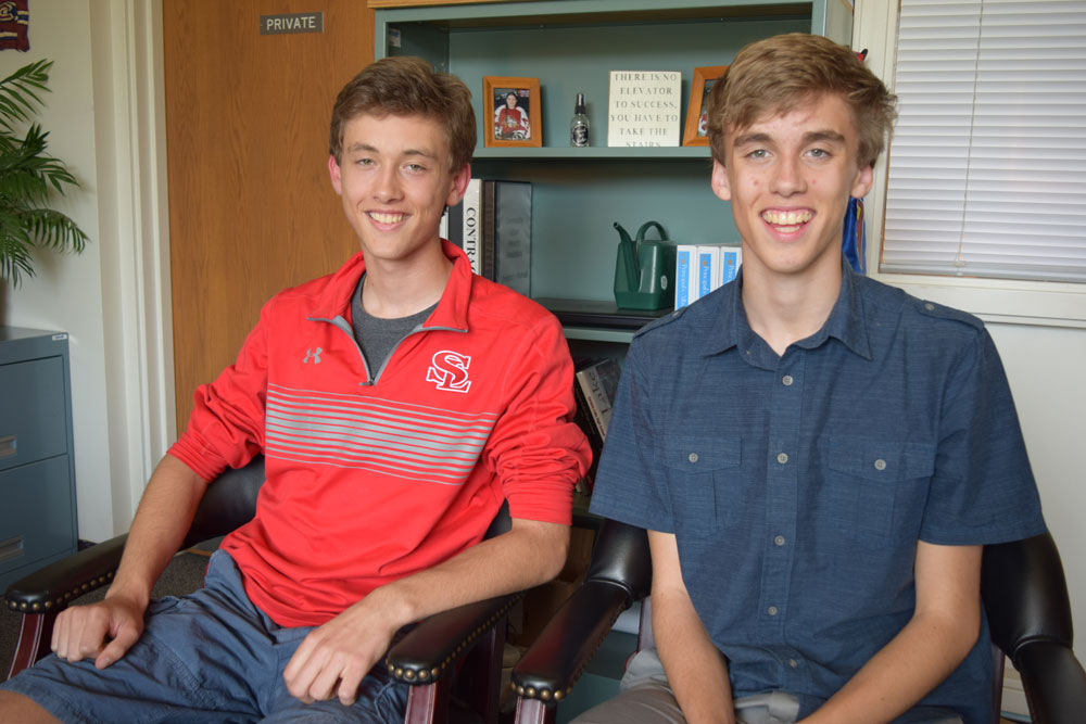 Fraternal twins Silas Swanson, right, and Witter Swanson are the valedictorian and salutatorian, respectively, of the Saranac Lake High School Class of 2017. They'll address their classmates at graduation on June 23. (Enterprise photo — Chris Knight)