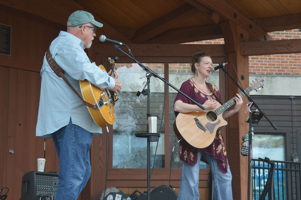 Father and daughter Jim and Gwen Tracy of Old Forge perform a free concert at the Mid's Park bandshell as part of Sunday's third annual Carry The Load Memorial Day Weekend event in Lake Placid. (Enterprise photo — Antonio Olivero)